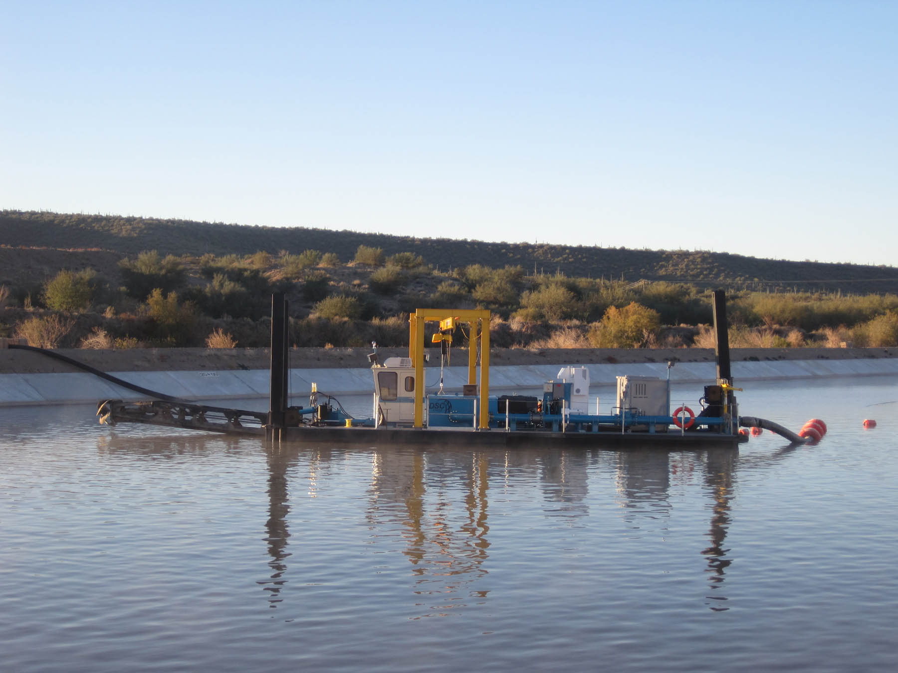 A DSC Barracuda Class electric-powered dredge is used to remove sediment in a settling basin for the Gila River in Arizona, an important source of irrigation water for the community.