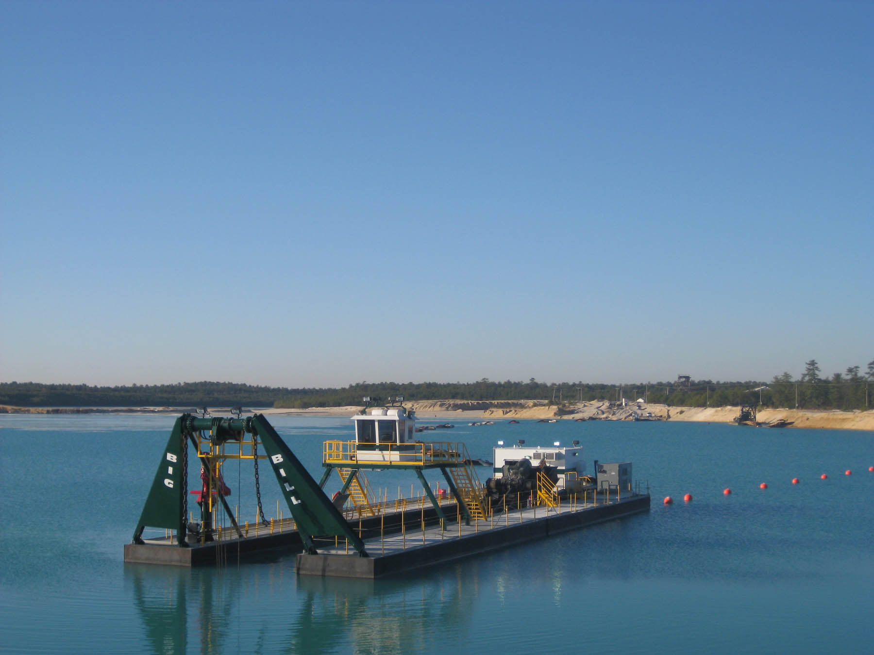 A DSC Marlin Class electric-powered dredge in an aggregate operation.  The dredge is used to dig into the bank of materials underwater and then pump the slurry to a processor on land.
