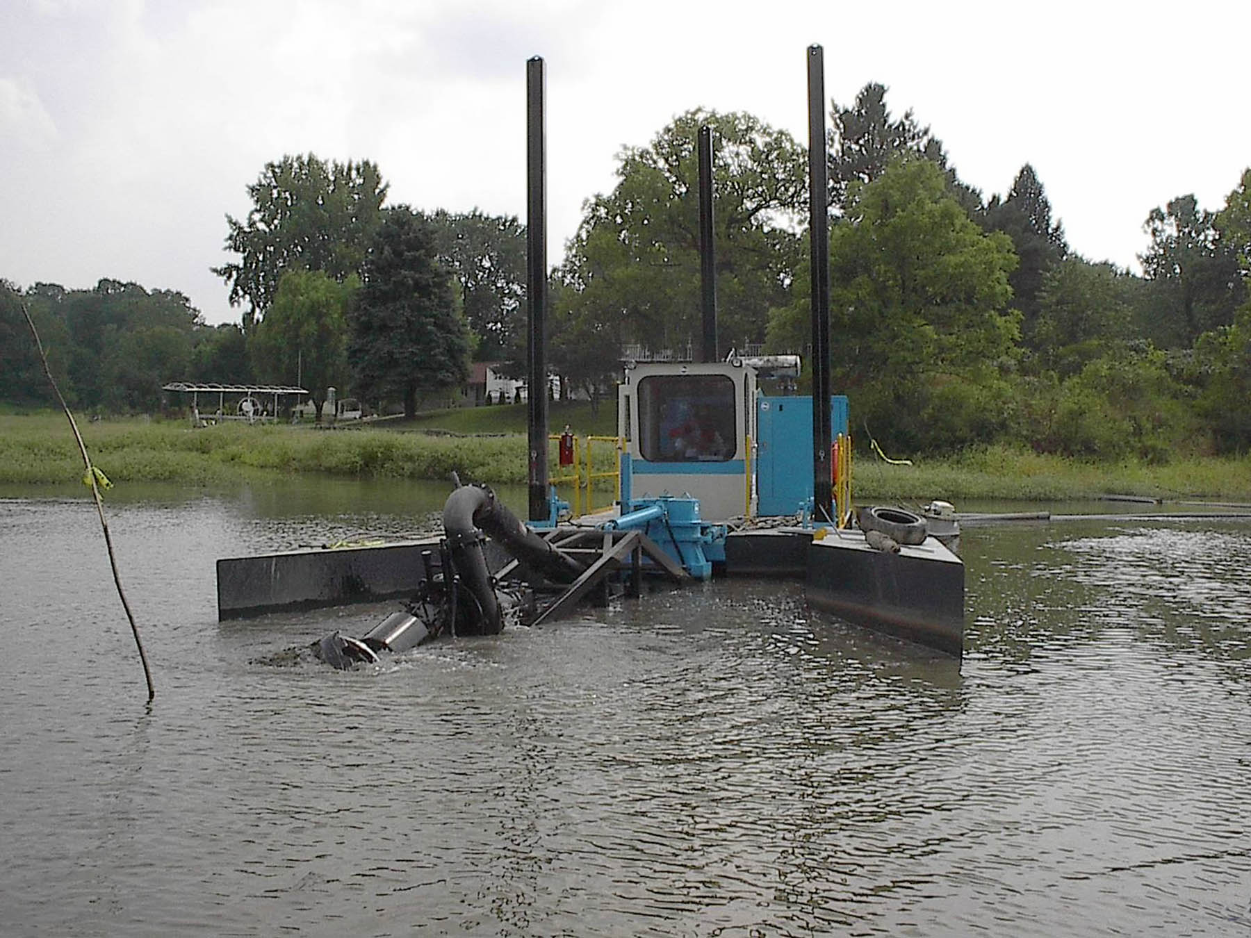 A DSC Moray Class dredging a residential channel. Navigational dredging is most commonly used in ports, harbors and shipping channels as a way to maintain these waterways.